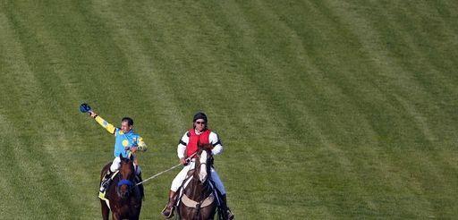 Victor Espinoza celebrates after riding American Pharoah to