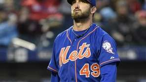 Mets starting pitcher Jonathon Niese walks to the