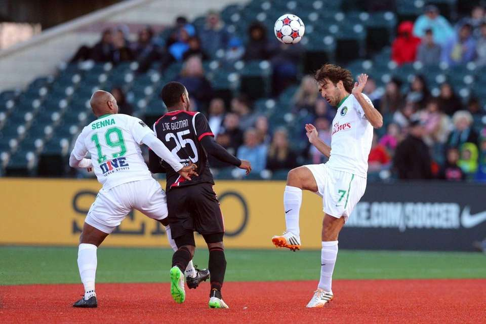 New York Cosmos forward Raul plays the ball