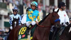 Jockey Victor Espinoza guides American Pharoah #18 on
