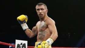 Vasyl Lomachenko, left, of the Ukraine is sent