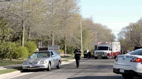 Suffolk Police investigate the scene of a fatal