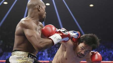 Floyd Mayweather Jr., left, trades blows with Manny