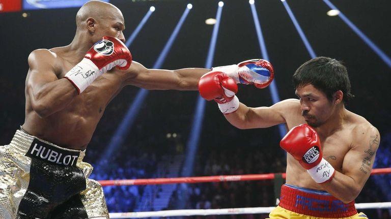 Floyd Mayweather Jr., left, squares off against Manny