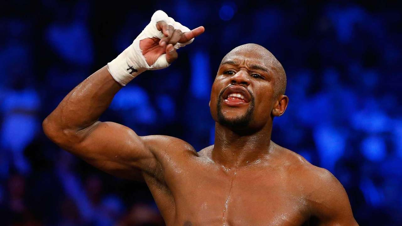 Floyd Mayweather Jr. reacts after the welterweight unification