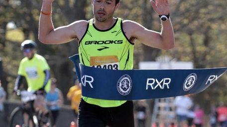 Men's half marathon winner Ryan McGuire, of Pennsylvania,
