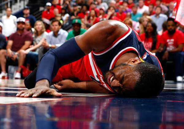 John Wall of the Washington Wizards reacts after