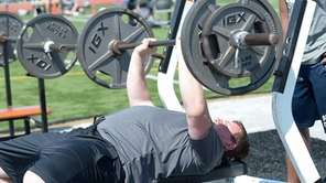 Longwood's Matthew Weiss works the bench press during