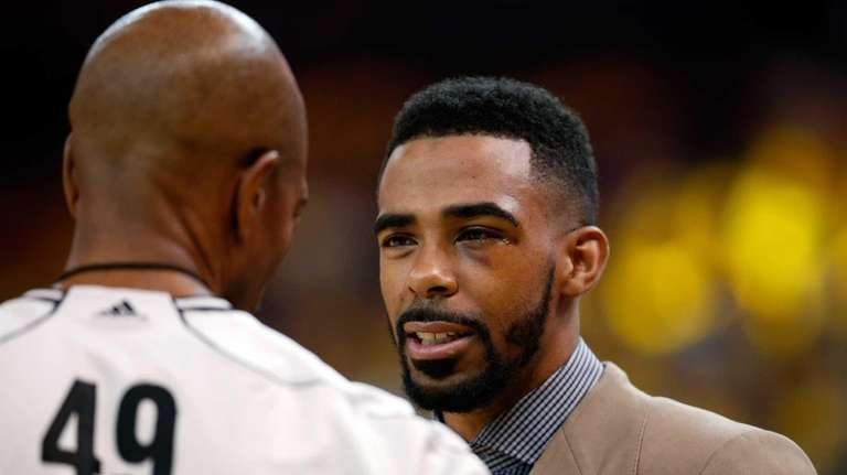 Injured Mike Conley #11 of the Memphis Grizzlies