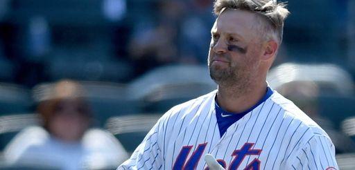The New York Mets' Michael Cuddyer takes off