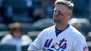 The New York Mets' Michael Cuddyer takes off