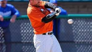 The Long Island Ducks' Lew Ford connects for