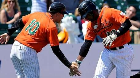 The Long Island Ducks' Prentice Redman is congratulated