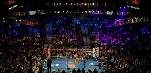 Floyd Mayweather Jr. throws a right at Manny