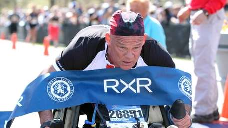 Peter Hawkins finishes the 2015 Long Island Marathon