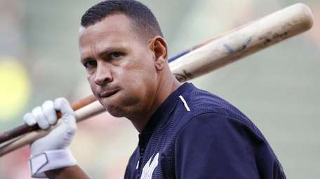 The New York Yankees' Alex Rodriguez warms up