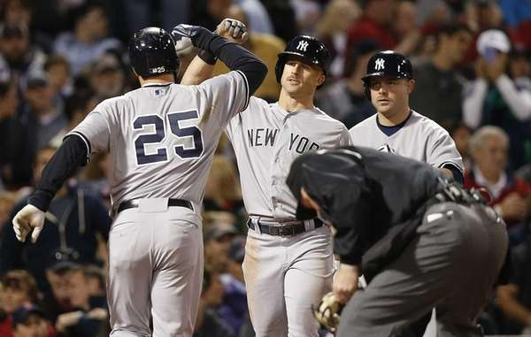 The New York Yankees' Mark Teixeira (25) celebrates