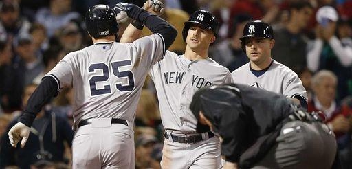 The New York Yankees' Mark Teixeira (25) celebrates