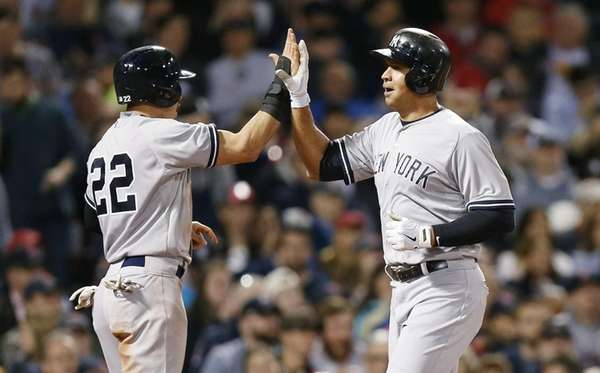 The New York Yankees' Alex Rodriguez, right, celebrates