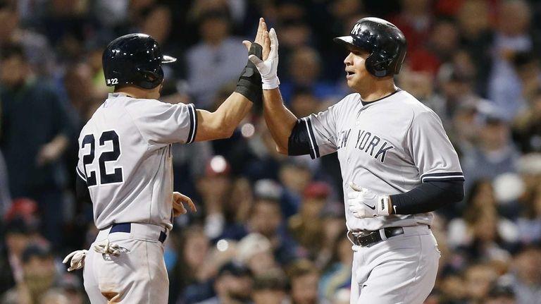 The New York Yankees' Alex Rodriguez, right, celebrates