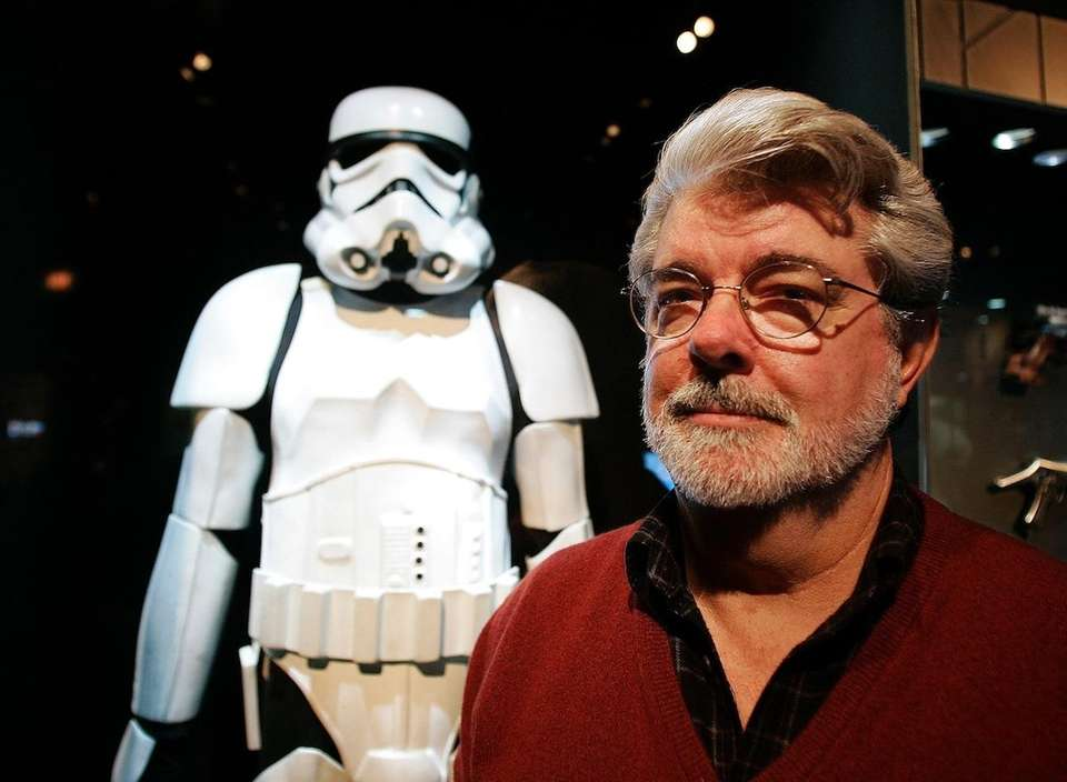 George Lucas and his two daughters make a