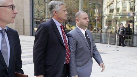 New York Senate Majority Leader Dean Skelos, center,