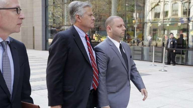 New York Senate Majority Leader Dean Skelos, center,