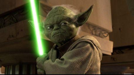 Yoda (voiced by Frank Oz) draws his light