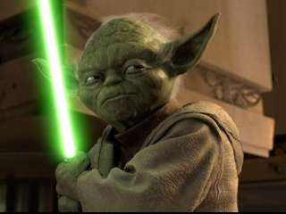 Yoda (voiced by Frank Oz) draws his light