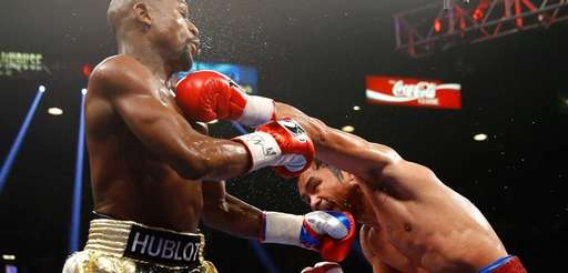 Floyd Mayweather Jr. exchange punches with Manny Pacquiao