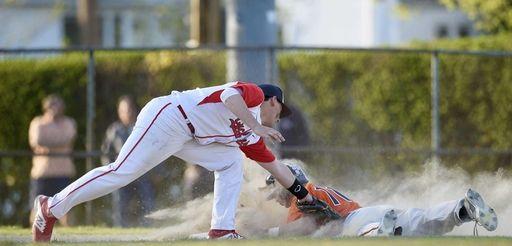 Manhasset shortstop Tim Curtis (11) slides in safely