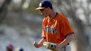 Manhasset pitcher Joe Enea (23) reacts after striking