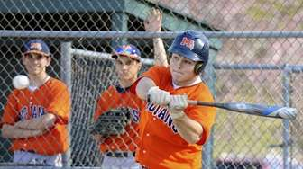 Manhasset leftfielder Anthony Vieto (16) hits an RBI