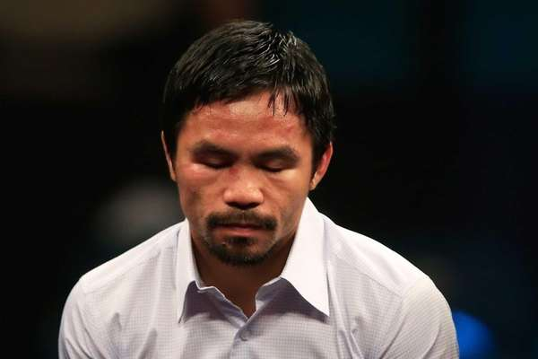 Manny Pacquiao answers questions during the post-fight news