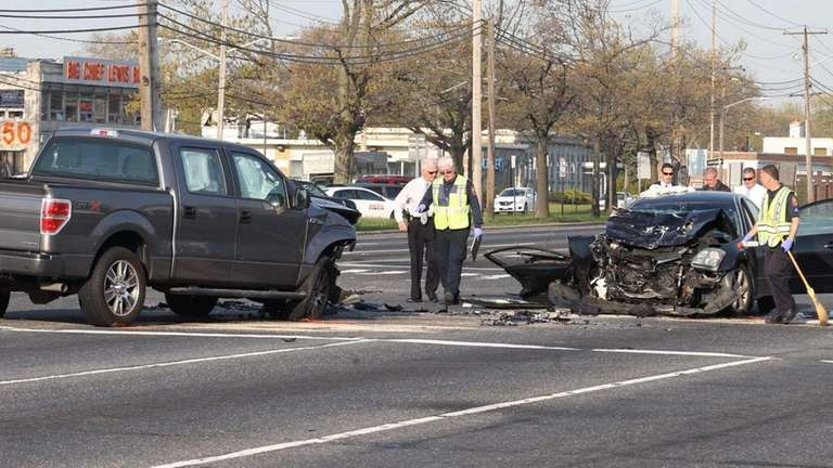 Investigators at the scene of a two-vehicle accident