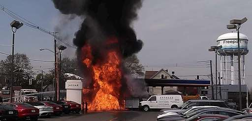 Fire and flames shoot out at a shuttered