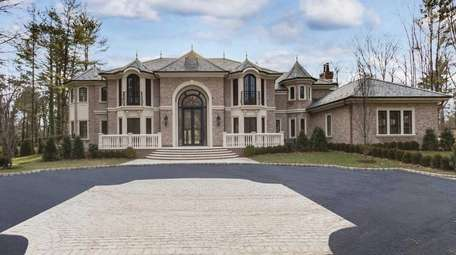 High-end details mark this newly constructed brick Colonial