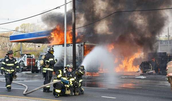 Flames shoot out at a shuttered gas station