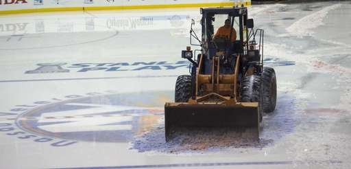 Union workers work to clear the melting ice