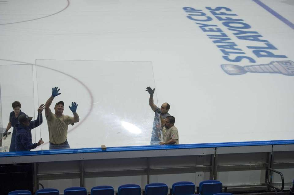 Union workers dismantle the ice rink as they