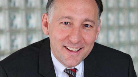 Michael Scotto, a Port Washington native and lawyer