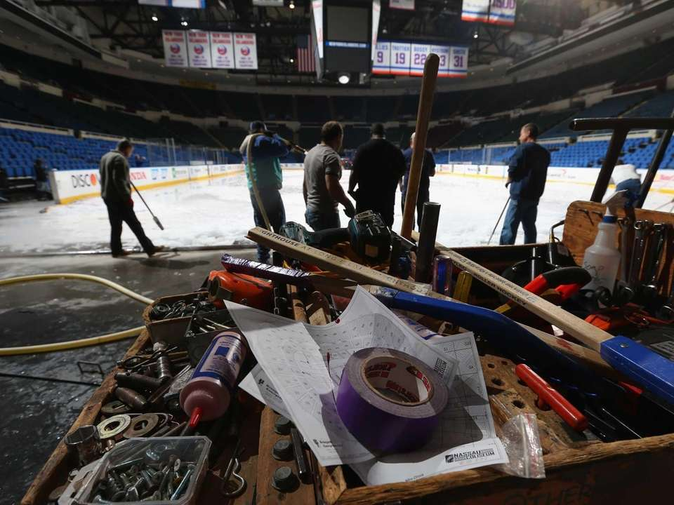 A closeup of arena workers' tools used to