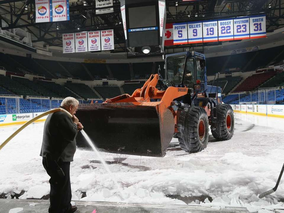 A payloader removes the ice from Nassau Coliseum