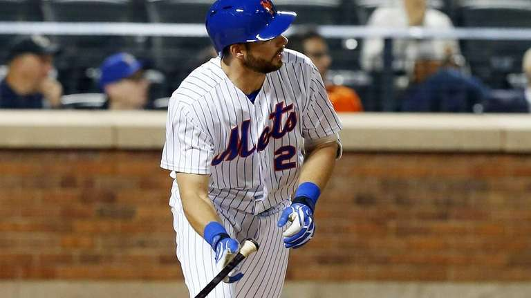 Kevin Plawecki of the New York Mets follows