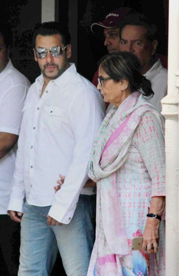 Bollywood actor Salman Khan walks with his mother