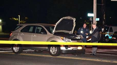 Suffolk County police investigate a motor-vehicle crash that