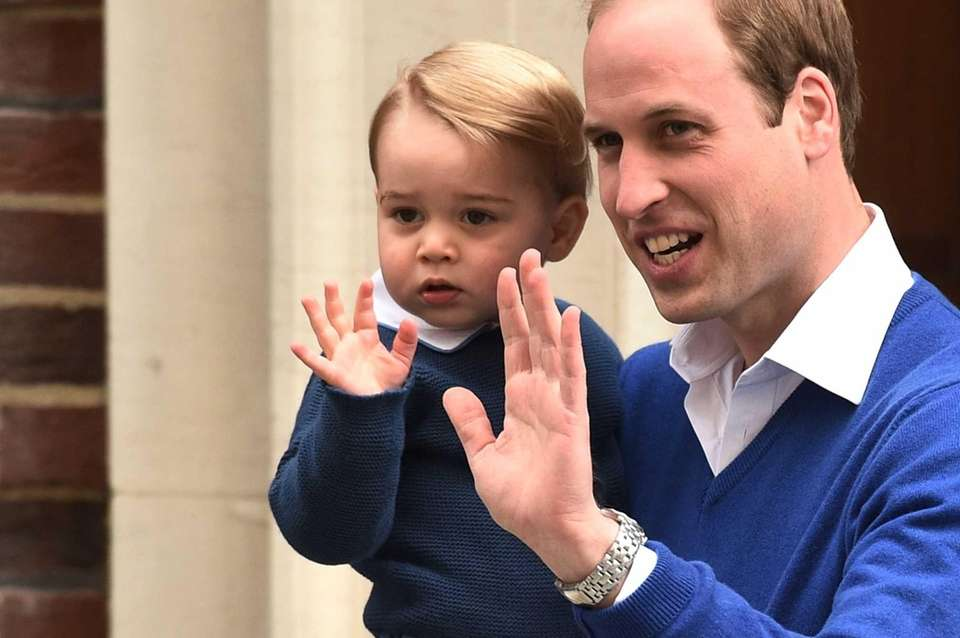 Britain's Prince George arrives with his father, Prince