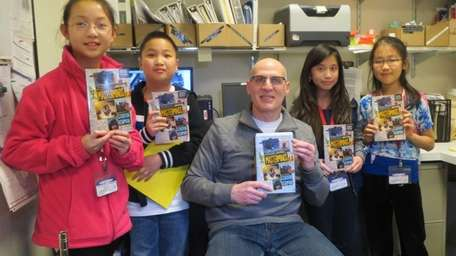 Author Gordon Korman with Kidsday reporters Amy He,