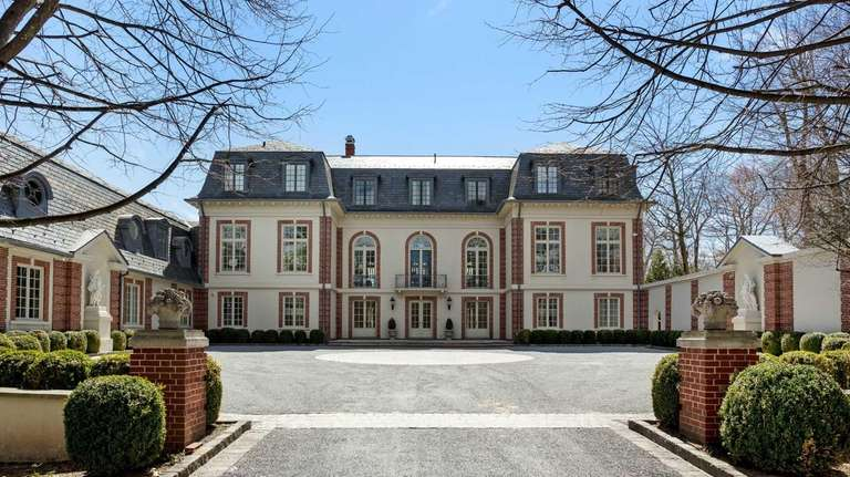 The restored 1916 French chateau-style home has seven