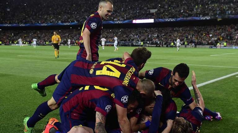 Barcelona midfielder Andres Iniesta, top left, celebrates with